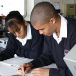 Doing chart work on board the SA Oranje