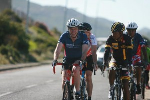 Lawhill cycling sponsor, Mr Mark Hamsher, rides alongside Songezo Jim during a 2015 training ride