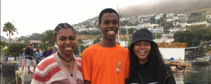 Sibobo with his mom (left) and sister, pictured before the lockdown